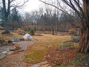 March:  the quiescent garden – plastic covered object is an Earth oven protected for the winter.